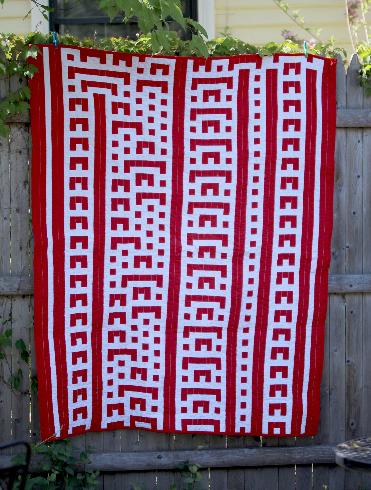 red and white quilt of rule 73 cellular automata pattern