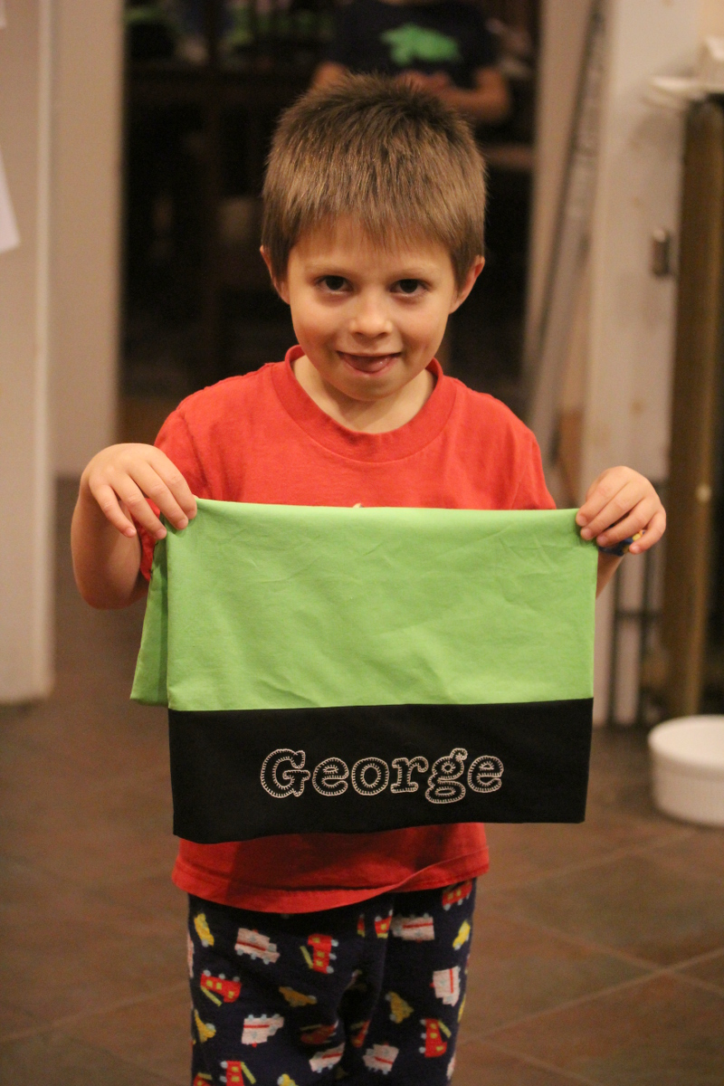 George holding a homemade pillowcase